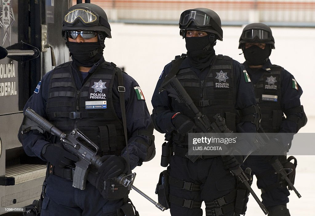 Mexican police satnd guard in front to t Pictures | Getty Images
