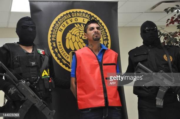 Mexican policemen escort Enrique Aurelio Elizondo Flores akaEl Arabe alleged member of Los Zetas drug cartel during his presentation to the press in...