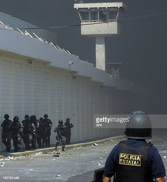 Mexican policemen guard the surroundings of 'La Mesa' prison in Tijuana on September 18 2008 60 percent of Mexican prisons are ruled for the...