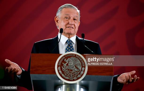 Mexican President Andres Manuel Lopez Obrador gestures as he speaks during a press conference at the Palacio Nacional in Mexico City on July 10 2019...