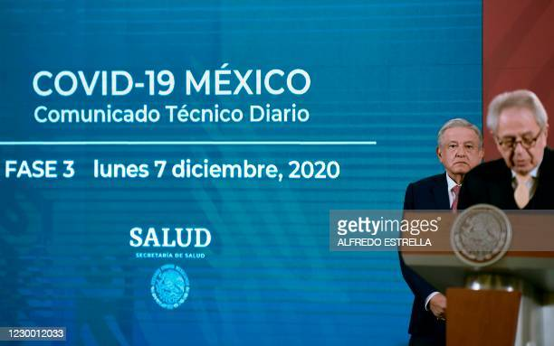 Mexican President Andres Manuel Lopez Obrador listens to Mexico's Health Minister Jorge Alcocer during his daily press conference at the Palacio...