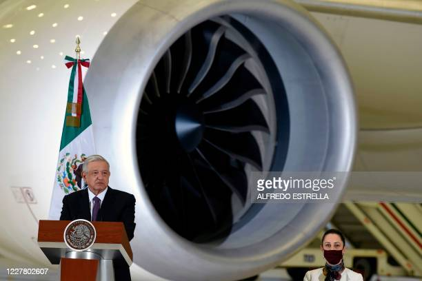 Mexican President Andres Manuel Lopez Obrador speaks during press conference, with the presidential plane in the background, at the presidential...