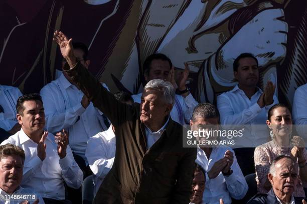 Mexican President Andres Manuel Lopez Obrador waves as he arrives to a rally to 'defend mexican dignity' in Tijuana, Baja California state, Mexico on...