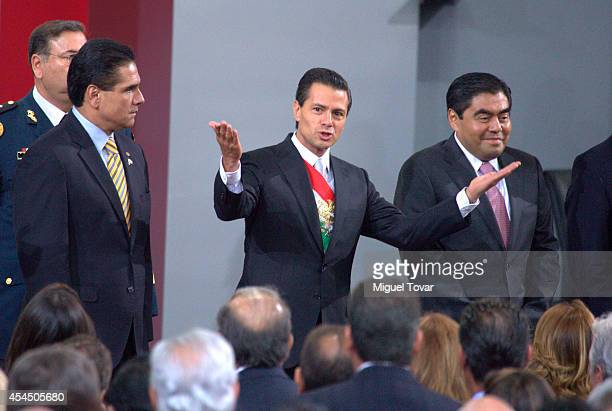 Mexican president Enrique Peña Nieto gestures during the Presentation of Second Anual Report of Mexican Federal Government at National Palace on...