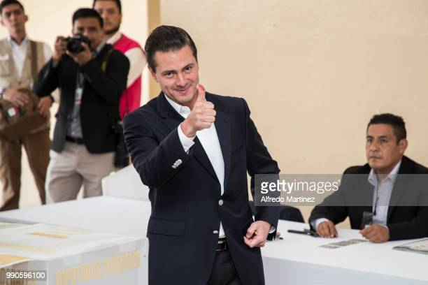 Mexican President Enrique Peña Nieto gives a thumb up after voting in polling station at Escuela Primaria El Pípila during the 2018 Presidential...