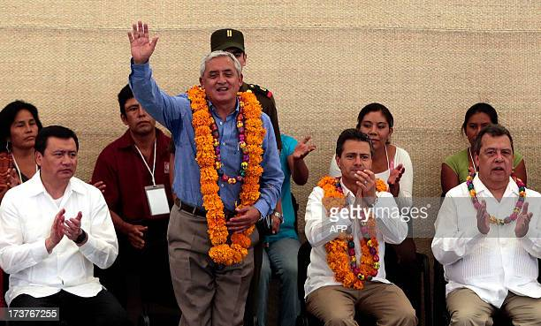 Mexican President Enrique Pena Nieto and Guatemalan President Otto Perez Molina attend an event within the National Crusade against Hunger campaign...