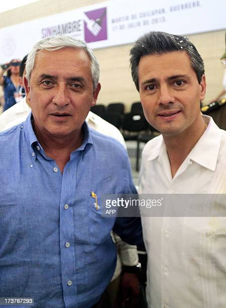 Mexican President Enrique Pena Nieto and Guatemalan President Otto Perez Molina pose for a picture during an event within the National Crusade...