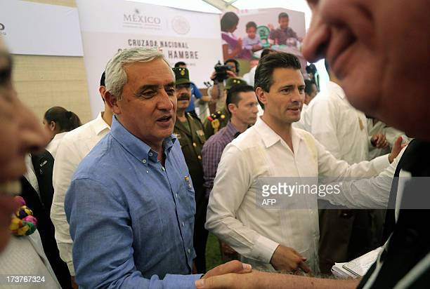 Mexican President Enrique Pena Nieto and Guatemalan President Otto Perez Molina greet followers during an event within the National Crusade against...