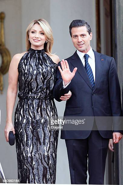 Mexican President Enrique Pena Nieto and Mexican First Lady Angelica Rivera pose prior to a official dinner with French President Francois Hollande...
