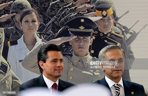Mexican President Enrique Pena Nieto and Mexico City's Mayor Miguel Angel Mancera attend the opening of the exhibition Armed Forces Pride for Serving...
