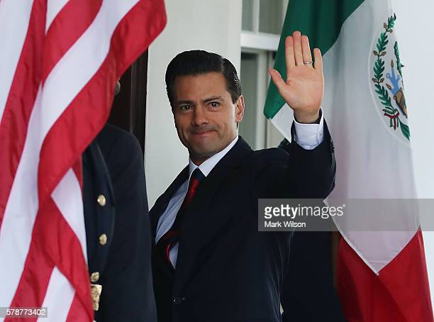 Mexican President Enrique Pena Nieto arrives at the White House for a meeting with US President Barack Obama July 22 2016 in Washington DC Later in...