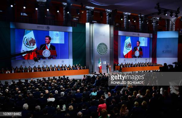 Mexican President Enrique Pena Nieto gives his sixth and final State of the Nation message, at the National Palace in Mexico City on September 3,...