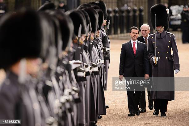 Mexican President Enrique Pena Nieto inspects a Guard of Honour during a Ceremonial Welcome at Horse Guards Parade on March 3 2015 in London England...