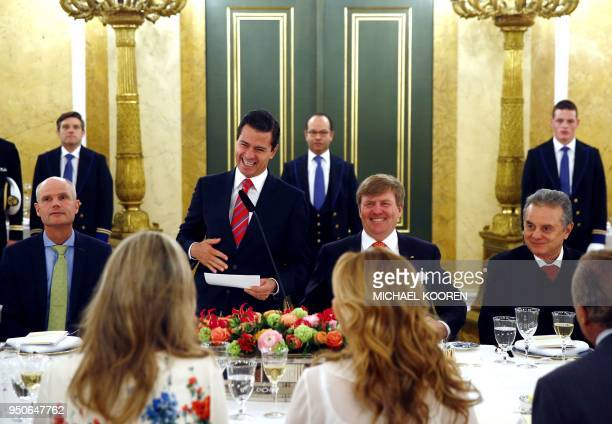 Mexican President Enrique Pena Nieto reacts flanked by Dutch King Willem-Alexander as he delivers a speech prior to a lunch event at the Noordeinde...
