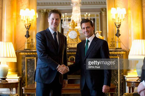 Mexican President Enrique Pena Nieto right and British Deputy Prime Minister and leader of the Liberal Democrats party Nick Clegg perform a posed...