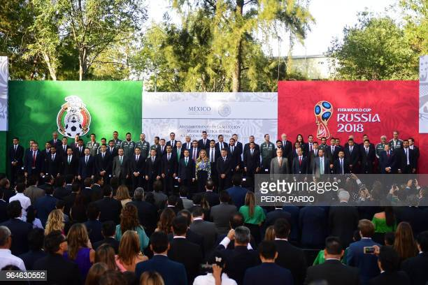 Mexican President Enrique Pena Nieto sings the national anthem along with his wife Angelica Rivera and the members of the Mexican national football...
