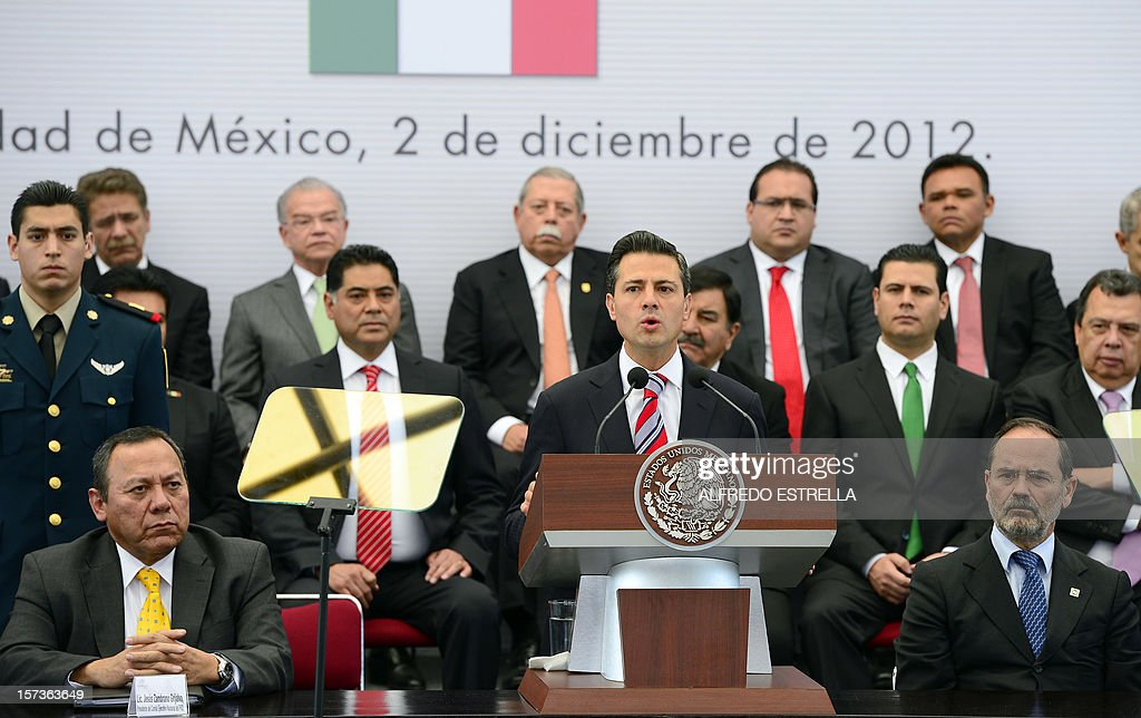 Mexican President Enrique Pena Nieto (C, bottom row) speaks next to the President of the Democratic Revolution Party (PRD), Jesus Zambrano (L, bottom row), and the President of the National Action Party (PAN), Gustavo Madero (R, bottom row), as they make the 'Pact for Mexico', on December 2, 2012 in Mexico City. Pena Nieto and the main three polical parties of Mexico, signed Sunday an agreement to launch reforms to strengthen democracy, fight social inequality and promote economical growth. AFP PHOTO/Alfredo Estrella