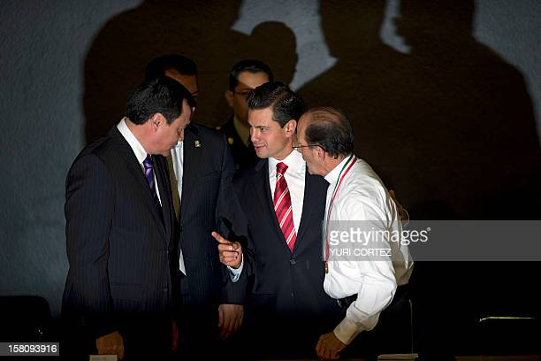Mexican President Enrique Pena Nieto speaks to Mexican Interior Minister Miguel Angel Chong next to Mexican Catholic priest Alejandro Solalinde...