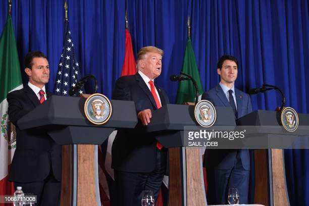 Mexican President Enrique Pena Nieto US President Donald Trump and Canadian Prime Minister Justin Trudeau deliver a statement on the signing of a new...