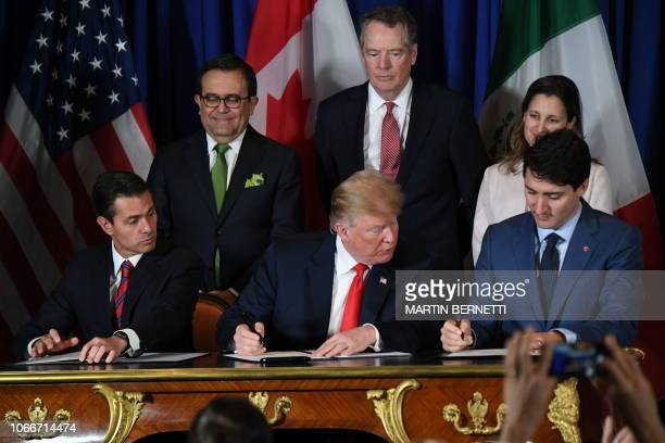 Mexican President Enrique Pena Nieto US President Donald Trump and Canadian Prime Minister Justin Trudeau sign a new free trade agreement in Buenos...