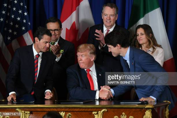 TOPSHOT Mexican President Enrique Pena Nieto US President Donald Trump and Canadian Prime Minister Justin Trudeau are pictured after signing a new...
