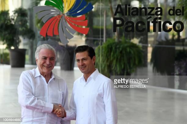 Mexican President Enrique Pena Nieto welcomes his Brazilian counterpart Michel Temer during the Pacific Alliance summit in Puerto Vallarta Jalisco...