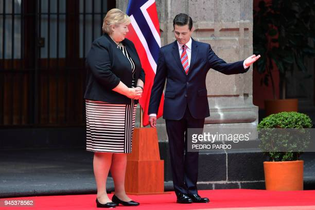Mexican President Enrique Pena Nieto welcomes Norwegian prime Minister Erna Solberg at the National Palace in Mexico City on April 12 2018 / AFP...