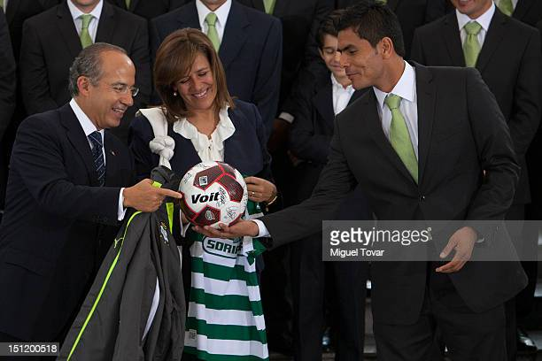 Mexican President Felipe Calderon Hinojosa and his wife Margarita Zavala receive the squad of Santos Laguna, current champions of the Mexican...