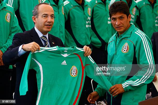Mexican President Felipe Calderon Hinojosa receives the Mexican jersey from the head coach Jose Luis Gonzalez during the sendoff of Mexican U17...