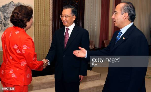 Mexican President Felipe Calderon introduces a member of his delegation to Chinese Premier Wen Jiabao during a meeting at the Zhongnanhai compound on...