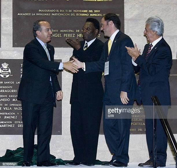 Mexican President Felipe Calderon shakes hand with Santos' President Carlos Fernandez with Brazilian football legend Edson Arantes Donacimento Pele...