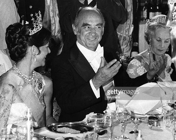 Mexican President Jose Lopez Portillo sits between Queen Silvia and Princess Lillian of Sweden at a state dinner at the Royal Palace in Stockholm,...