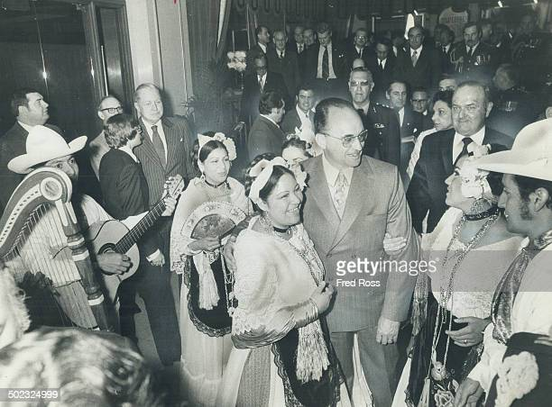 Mexican President Luis Echeverria is surrounded by dancers from Vera Cruz; Mexico; on his arrival at the Royal York Saturday. Echeverria addressed a...