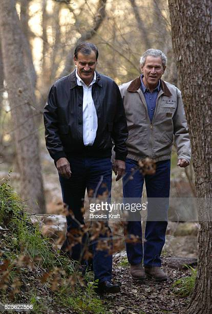 Mexican President Vicente Fox and US President George W. Bush take a walk on the Bush Ranch in Crawford. The two leaders were hoping the weekend...