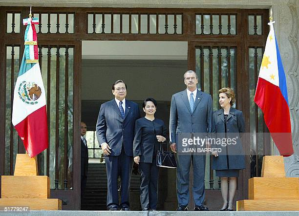 Mexican President Vicente Fox his wife Marta Sahagun the President of the Philippines Gloria MacagapalArroyo and her husband Jose Miguel Arroyo pose...
