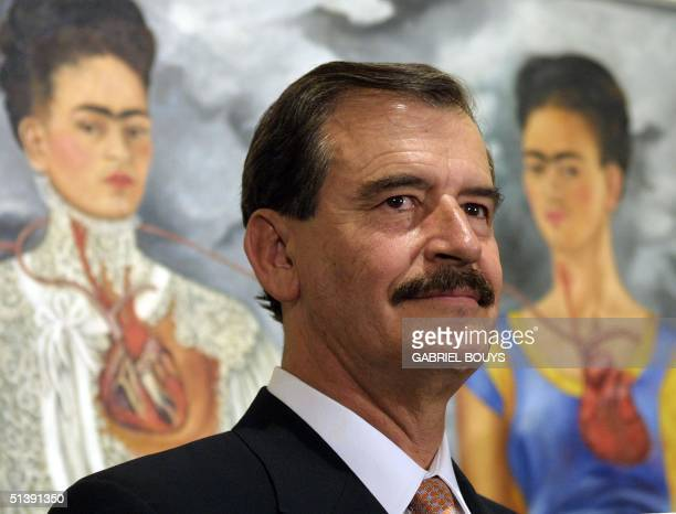Mexican President Vicente Fox Quesada inaugurates the exhibition of Mexican painter Frida Kahlo at Rome's National gallery of modern Art 17 October...