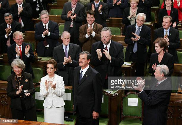 Mexican President Vicente Fox receives a standing ovation after addressing the House of Commons on Parliament Hill in Ottawa 25 October 2004 as...