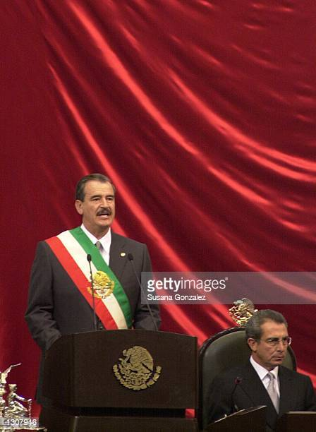 Mexican President Vicente Fox wears a symbolic Mexican flag sash after being sworn in as president December 1 2000 in Mexico City Mexico Outgoing...