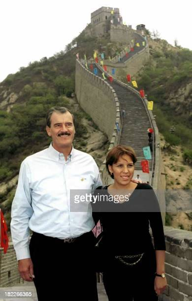 Mexican President Vincente Fox and his daughter Ana Cristina pose for a picture on the Great Wall in Badaling northern suburb of Beijing 07 June 2001...