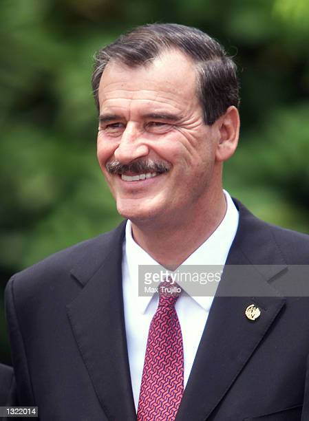 Mexican President Vincente Fox smiles during a group photo with other Central American presidents June 15 2001 in San Salvador El Salvador The...