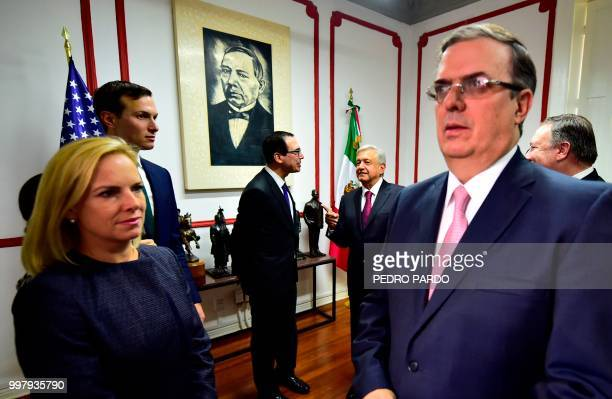Mexican Presidentelect Andres Manuel Lopez Obrador speaks with US Treasury Secretary Steven Mnuchin next to US Secretary of State Mike Pompeo White...