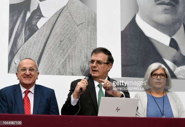 Mexican Presidentelect Andres Manuel Lopez Obrador's appointed Foreign Secretary Marcelo Ebrard delivers a press conference next to Lopez Obrador's...
