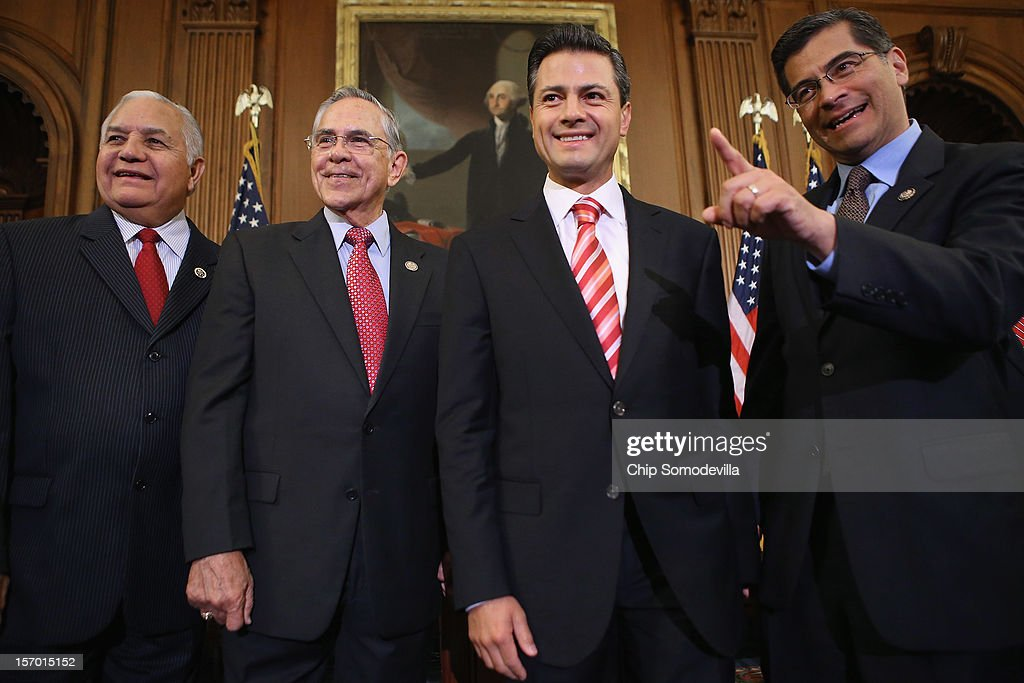 Mexican President-Elect Enrique Pena Nieto (2R) briefly answers a reporter's question with members of Congress (L-R) Rep. Silvestre Reyes (D-TX), Rep. Ruben Hinojosa (D-TX) and Rep. Xavier Becerra (D-CA) in the Rayburn Room at the U.S. Capitol November 27, 2012 in Washington, DC. Nieto, of Mexico's Institutional Revolutionary Party, will also visit the White House and meet with President Barack Obama today, days before he takes office on December 1.