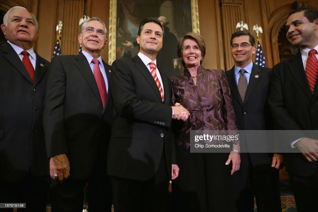 Mexican President-Elect Enrique Pena Nieto (3L) poses for photographs with members of Congress (L-R) Rep. Silvestre Reyes (D-TX), Rep. Ruben Hinojosa (D-TX), House Minority Leader Nancy Pelosi (D-CA), Rep. Xavier Becerra (D-CA) and Rep. Henry Cuellar (D-TX) in the Rayburn Room at the U.S. Capitol November 27, 2012 in Washington, DC. Nieto, of Mexico's Institutional Revolutionary Party, will also visit the White House and meet with President Barack Obama today, days before he takes office on December 1.
