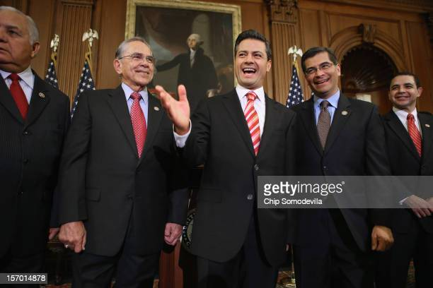 Mexican PresidentElect Enrique Pena Nieto shares a laugh with members of Congress Rep Silvestre Reyes Rep Ruben Hinojosa Rep Xavier Becerra and Rep...