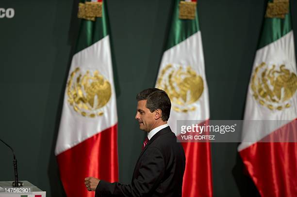 Mexican presidential candidate for the Institutional Revolutionary Party Enrique Peña Nieto arrives to deliver a speech after learning the first...