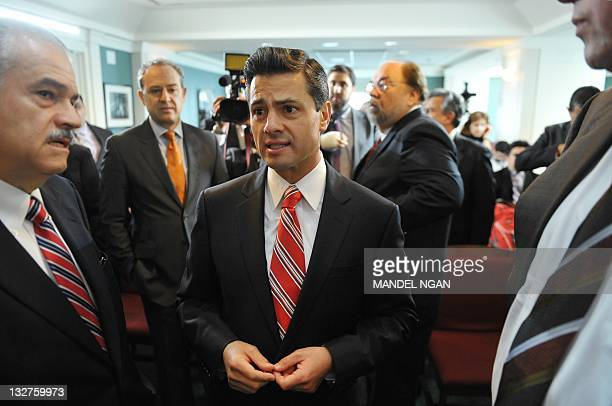 Mexican presidential hopeful Enrique Pena Nieto chats with attendees as he arrives to speak at the Woodrow Wilson Center November 14, 2011 in...