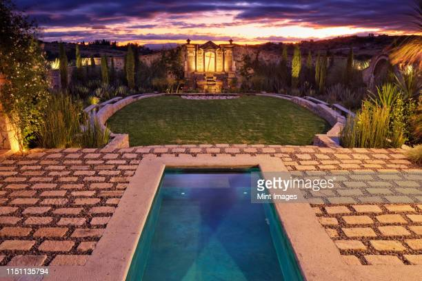 mexican ranch house garden - stone house stock pictures, royalty-free photos & images
