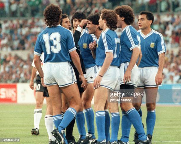 Mexican referee Edgardo Codesal Mendez is surrounded by angry Argentinean players Nestor Lorenzo Jose Basualdo Jorge Burruchaga Roberto Sensini...