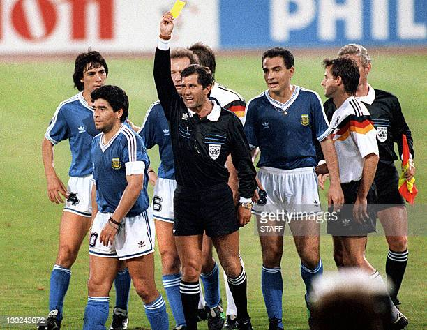 Mexican referee Ernesto Codesal Mendez gives a yellow card to Argentinian midfielder Diego Maradona 08 July 1990 in Rome during the World Cup soccer...